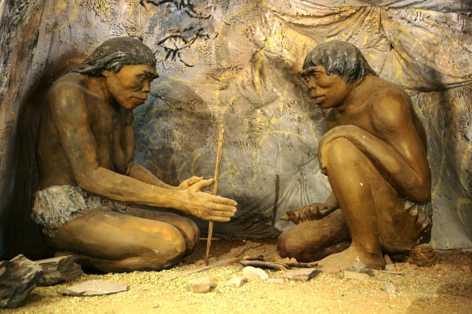 cavemen make fire
