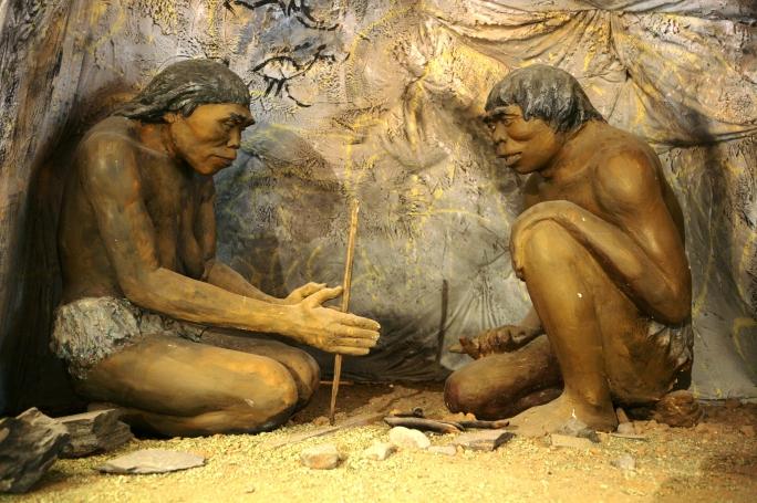 cavemen make fire